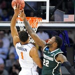 MSU's Branden Dawson (22) blocks a shot by Virginia's Justin Anderson during the Spartans' 60-54 NCAA tournament win on Sunday in Charlotte, N.C.