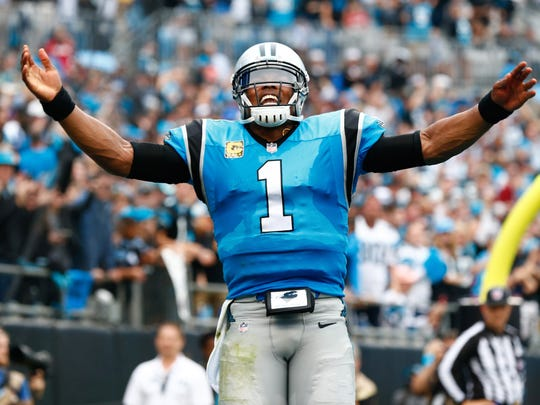 Carolina Panthers quarterback Cam Newton celebrates after a touchdown in the second quarter against the Atlanta Falcons at Bank of America Stadium.