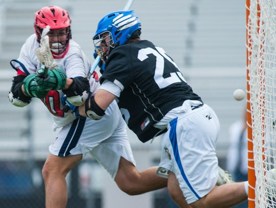 Worcester Prep attack Sam Cantello (20) takes a shot