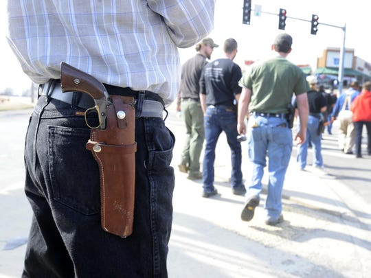 A Mountain Home man openly carries a pistol in this March 2014 photograph. According to a recent online report, Mountain Home was ranked as the second-most redneck city in Arkansas.