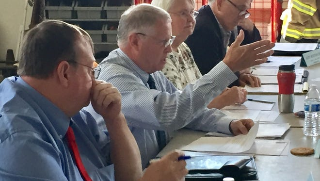 Cascade County Commissioner Jim Larson, center, asks a question Thursday about a proposed fire service fee increase in Dearborn.