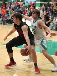 Ballinger High School's Chance Parker (32) is guarded