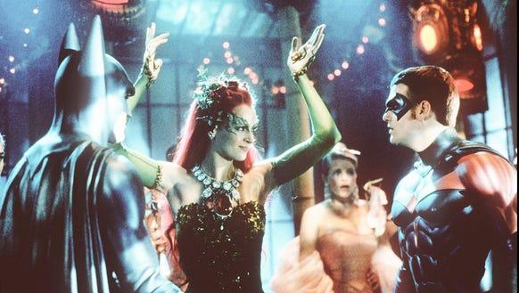 George Clooney as Batman, left, Uma Thurman as Poison