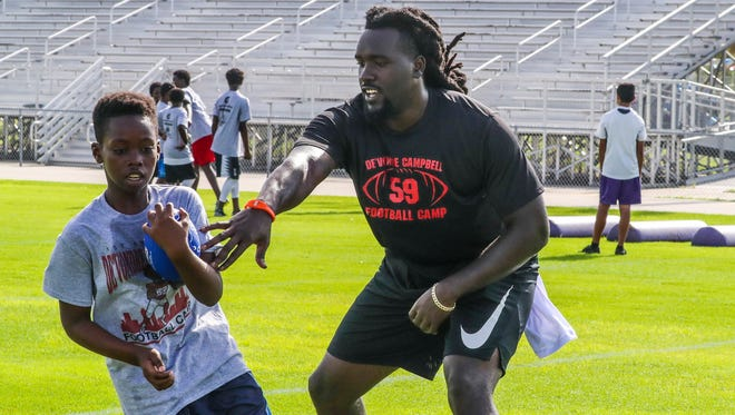 De'Vondre Campbell works with youths at Cypress Lake, his alma mater during a football camp this summer for the more than 125 kindergarten-eighth graders and another two-hour session for high-schoolers. Campbell, a linebacker for the Atlanta Falcons, is on the Pro Bowl ballot.