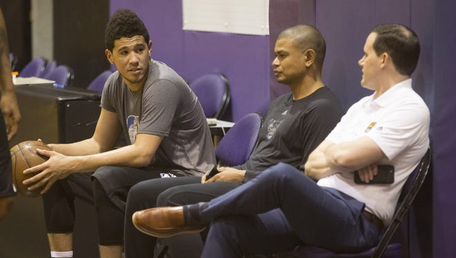 Suns' Devin Booker, head coach Earl Watson and GM Ryan McDonough talk on the sidelines at the Suns practice Court in Talking Stick Resort Arena in Phoenix, Ariz. on July 6, 2017.