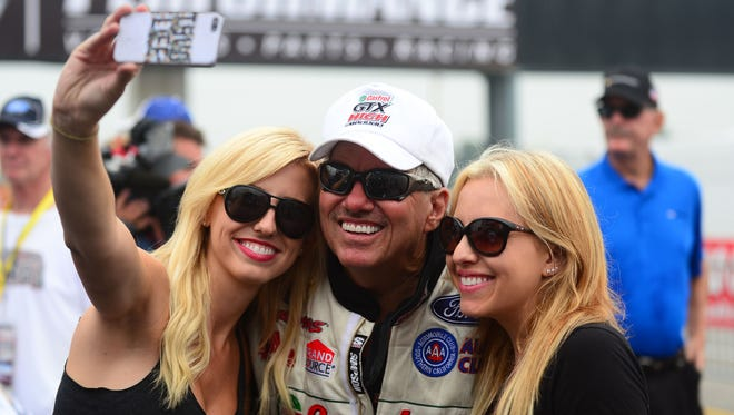 John Force and daughters Courtney (left) and Brittany are planning to relaunch their reality TV show in hopes of attracting new sponsors.
