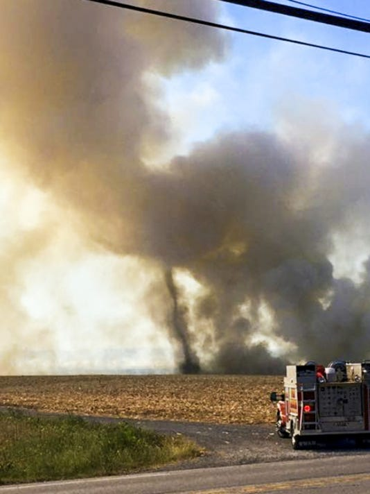 Submitted A fire truck turns down a farm lane on the way to battle a swift-moving cornfield fire in North Londonderry Township Wednesday near South Forge Road and Park Drive. This photo was submitted by Cindy Wartluft Grant.