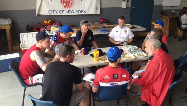 FDNY riders eat pizza at Rockledge fire station.