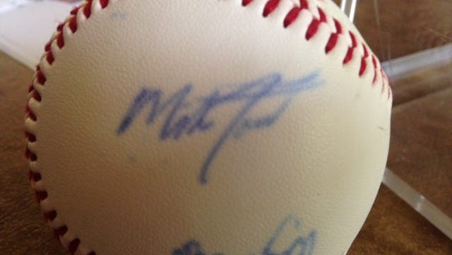 Mike Trout autographed this ball on  the day his picture was taken for the 2009 All-South Jersey team