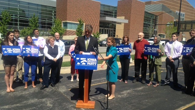 Iowa Democratic Party Chairman Scott Brennan and Democratic National Committee Chairwoman Debbie Wasserman Schultz held a news conference today, June 13, 2014, in Des Moines to criticize Republicans who will be attending tomorrow's Iowa GOP convention.