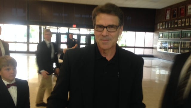 Texas Gov. Rick Perry chats with The Des Moines Register after his speech in Algona, Iowa tonight, July 19, 2014.