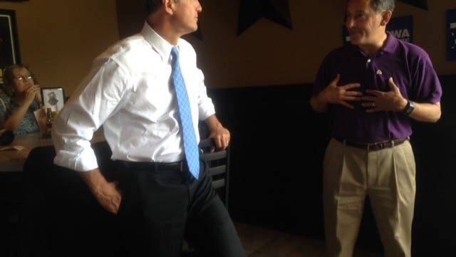 Polk County Democratic Party Chairman Tom Henderson, right, introduces Maryland Gov. Martin O'Malley at an activists' rally at a Beaverdale bar on June 21, 2014.