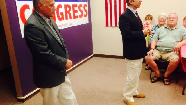 Republican U.S. Rep. Steve King, left, listens to U.S. Sen. Rand Paul of Kentucky give a speech to about 50 people at a GOP campaign office in Sioux City this afternoon, Aug. 4, 2014.