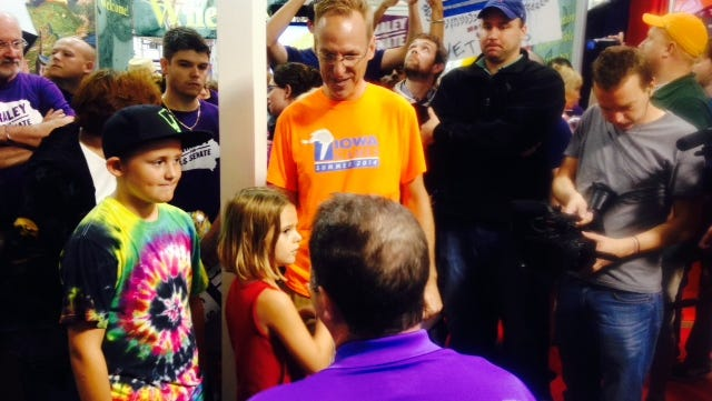 Democratic U.S. Rep. Bruce Braley of Waterloo chats with fairgoers after his speech at The Des Moines Register Soapbox at the state fair.