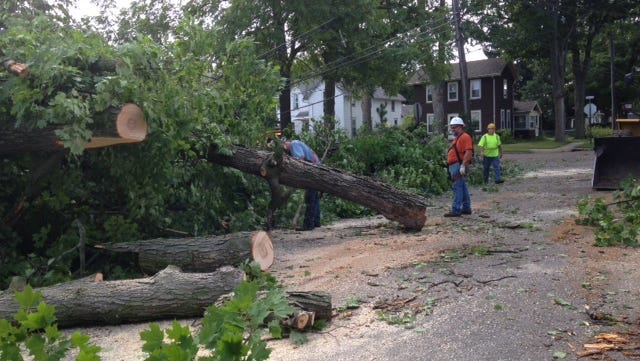 Crews survey damage Saturday from thunderstorms that roared through Eaton Rapids on Friday night.