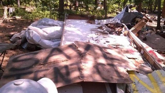 Hope crushed amid the rubble: Rally signs crushed by bulldozers in Lakewood's Tent City