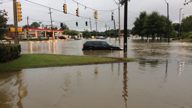 An  automobile is stuck in flood waters at Stage and Bartlett Boulevard.