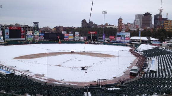 This is Frontier Field? Last weekend's spring storm turned a perfectly green field into a white nightmare.