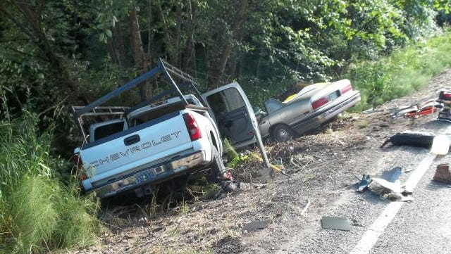 A two-vehicle crash just east of Woodburn sent three people to Portland hospitals