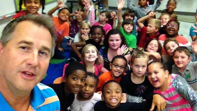 Leaf-Chronicle Multimedia Journalist Greg Williamson and the Last group of 2nd graders at Glenellen Elementary career day