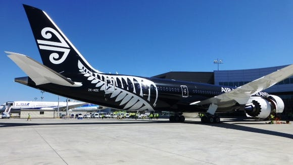 A view of Air New Zealand's 787-9 airplane in its black livery.