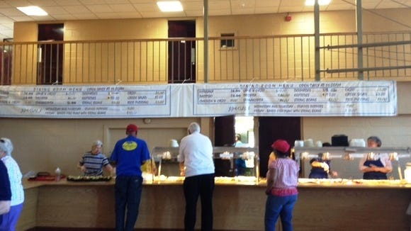 Dining is available inside the church hall. It's cafeteria-style service. I think the most expensive item was a $15 lamb dish. Most everything else is under $10.