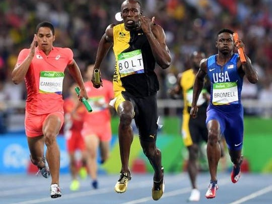 Usain Bolt leads Jamaica to 4x100 title.
