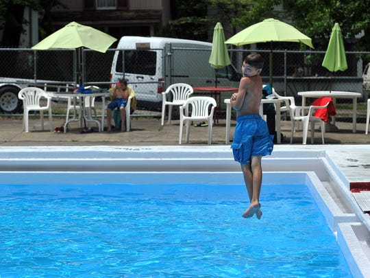 Josiah Gahm, 11, spins as she dives into the Copeland Swimming Pool Wednesday, June 15, 2016, at the Lancaster Camp Ground in Lancaster.