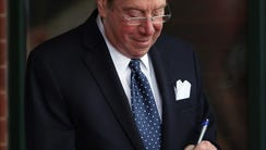 John Sterling signs an autograph before the game at
