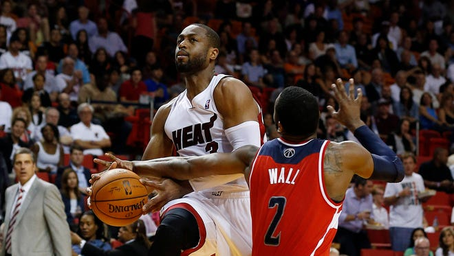Miami Heat shooting guard Dwyane Wade (3) and Washington Wizards point guard John Wall (2) lead teams that still don't know what their playoff seeding will be.