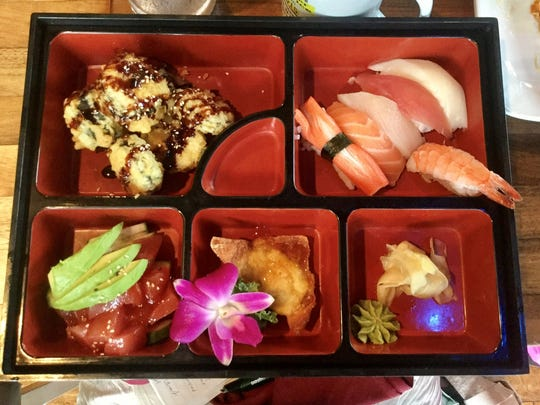 The lunch sushi bento box at Thai Thai Noodle Bar includes sushi, tuna salad and fried foods.