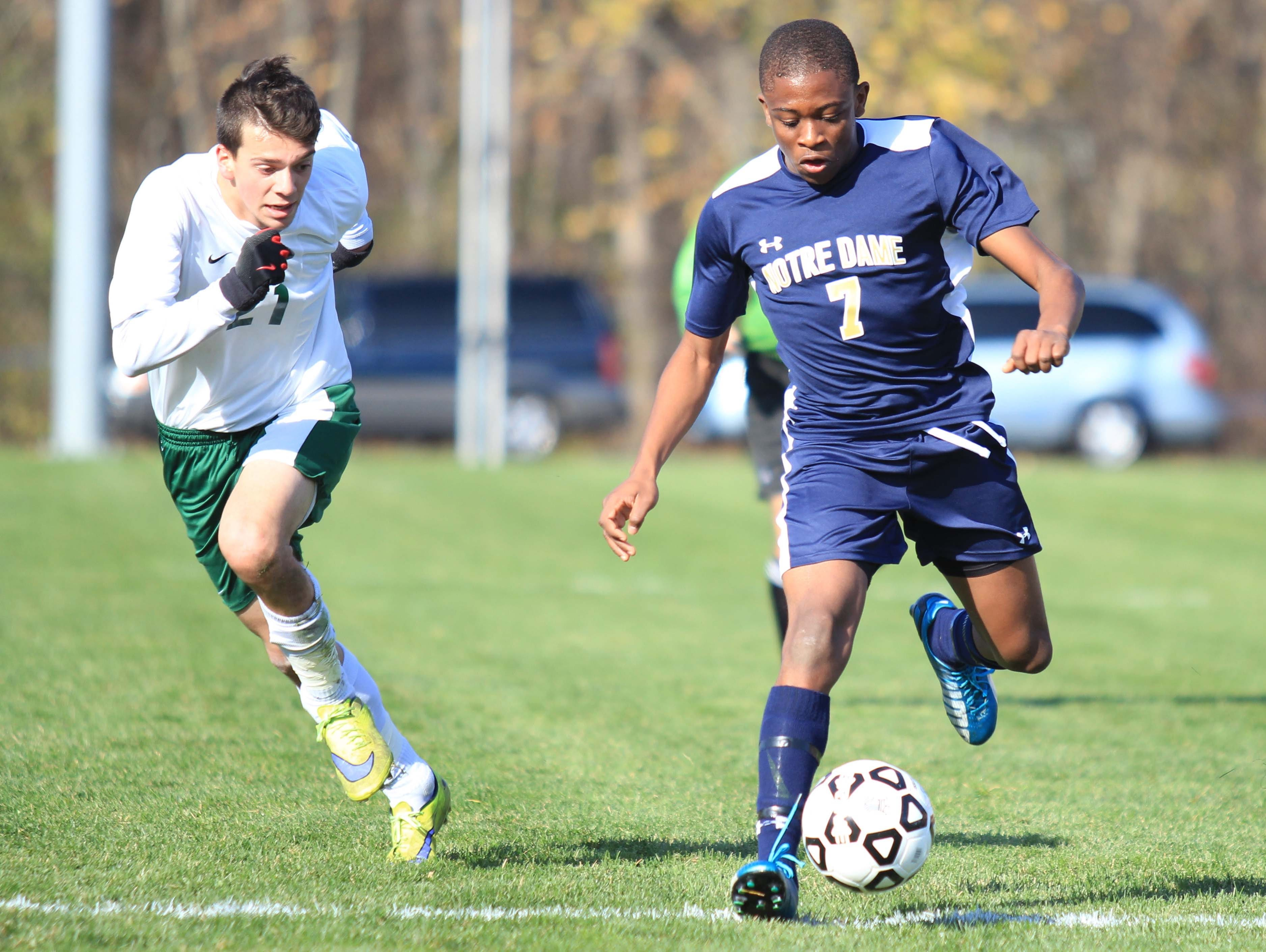 Notre Dame's Rocco Coulibaly (right) leads the attack during the NYSPHSAA Class C final in Middletown.