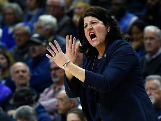 Quinnipiac head coach TriciaFabbri gestures during the first half a second-round game against Connecticut in the NCAA women's college basketball tournament in in Storrs, Conn., Monday, March 19, 2018. (AP Photo/Jessica Hill)