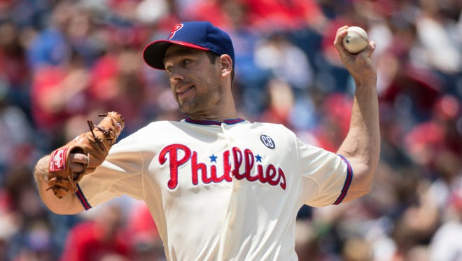 Philadelphia Phillies starting pitcher Cliff Lee throws during the first inning of a baseball game against the Cincinnati Reds, Sunday, May 18, 2014, in Philadelphia. (AP Photo/Chris Szagola)