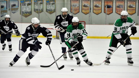 Top-line forwards Richie Neufeld (14) and Sean Grant (11) have helped the Kinnelon hockey team win 4-of-5 entering the MCSSIHL Mennen Cup tournament.