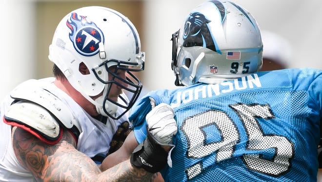 Tennessee Titans tackle Taylor Lewan (77) blocks Carolina Panthers defensive end Charles Johnson (95) during a joint training camp practice at Saint Thomas Sports Park Wednesday, Aug. 16, 2017 in Nashville, Tenn..