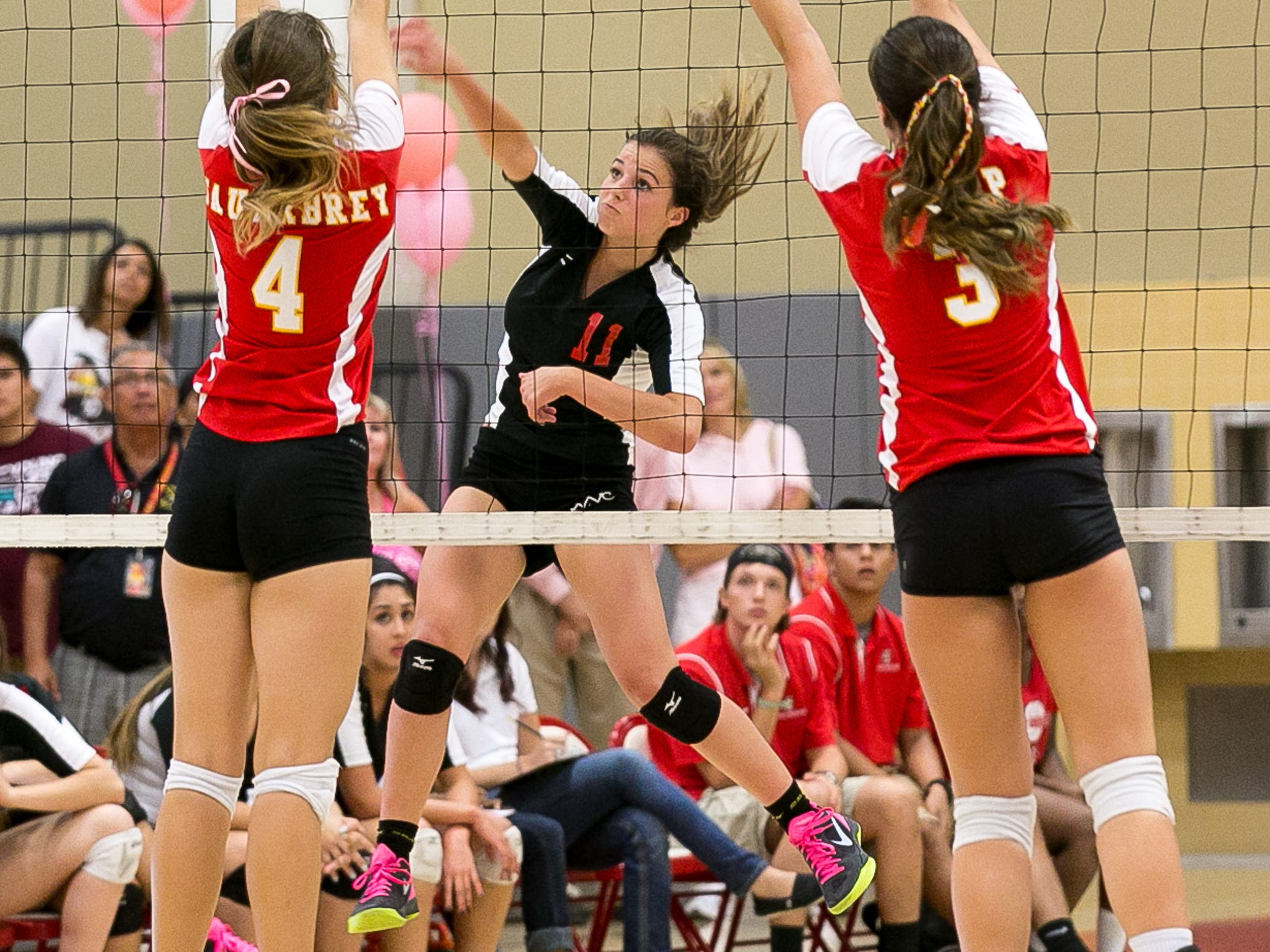 Palm Springs Mary Lake (No. 11) hits the ball against Palm Desert in a DVL volleyball game held at Palm Desert High School Thursday evening, October 16, 2014. Photo by Gerry Maceda, Special to The Desert Sun