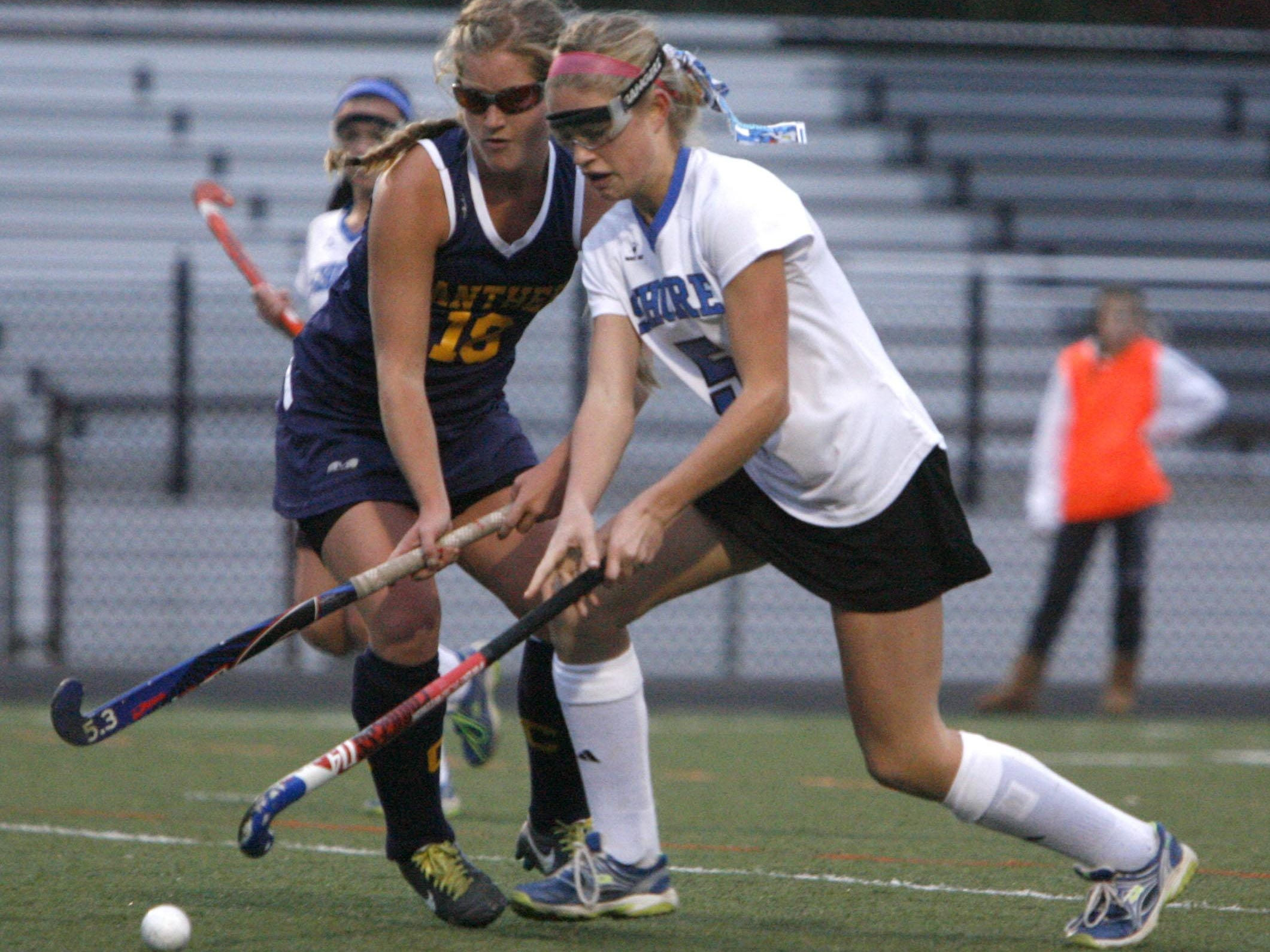 Jane Hatzell of Collingwood, left, and Shore Regional's Jessica Welch compete in the Field Hockey Group 1 State Championship game at Toms River East High School Nov. 16, 2013. Shore Regional defeated Collingswood 3-1. Photo by Vincent DiSalvio / Special to The ASBURY PARK PRESS