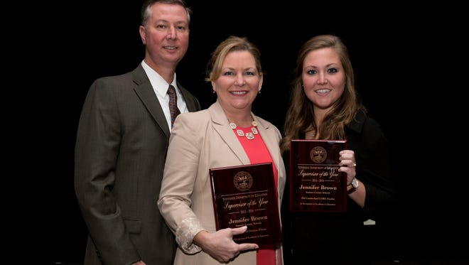 Jennifer Brown is pictured with husband Lyndon and daughter Hannah.