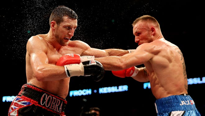 Carl Froch of England, left, and Mikkel Kessler of Denmark during their Super Middleweight Unification bout in 2013.