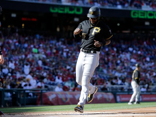Pittsburgh Pirates' Josh Bell scores on a three-run double by Max Moroff during the first inning of a baseball game against the Washington Nationals, Sunday, Oct. 1, 2017, in Washington. (AP Photo/Mark Tenally)
