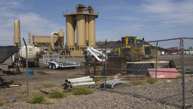 This file photo shows Fisher Sand and Gravel's asphalt batch plant in south Phoenix. The company, which has been chosen to build a border-wall prototype, has been cited hundreds of times by state and local officials for violating environmental regulations.