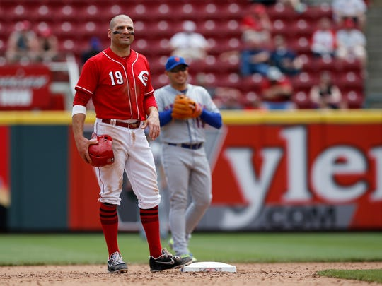 Cincinnati Reds first baseman Joey Votto (19) stands on second between pitches in the bottom of the sixth inning of the MLB National League game between the Cincinnati Reds and the New York Mets at Great American Ball Park in downtown Cincinnati on Wednesday, May 9, 2018. The Reds won 2-1 on a 10th inning walk off home run by Adam Duvall.