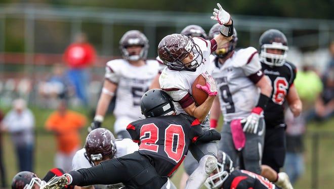 Newark Valley's Codi Boda tackles Sidney's David Gannon in the second quarter at Newark Valley on Saturday, October 14, 2017. Thomas La Barbera / Correspondent