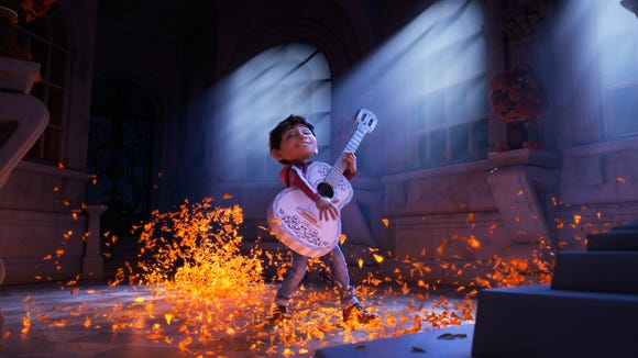 Though his family isn't big into music, Miguel (voiced by Anthony Gonzalez) jams out in Pixar's animated 'Coco.'