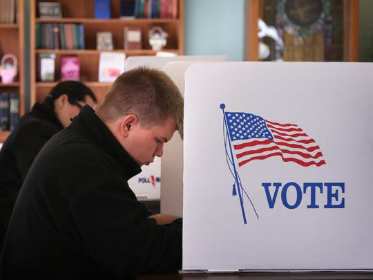 Brandon Robertson, 18, votes for the first time at
