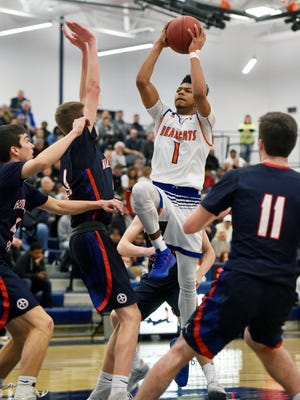 York High's Kyree Generett shoots against Holy Ghost Prep in the first half of a first-round PIAA Class 5A boys' basketball game Friday, March 9, 2018, at West York.