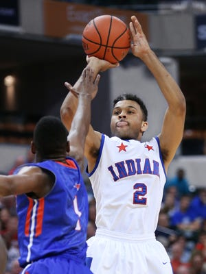 Indiana's James Blackmon Jr. fires a shot over Kentucky's Christen Cunningham in the first half of the Indiana High School All-Stars game held at Bankers Life Fieldhouse on Saturday, June 14, 2014. Indiana won 111-99.