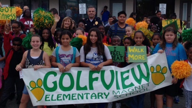 """Golfview Elementary Magnet celebrated """"Walk to School"""" day this morning, an event that drew the school's drum corps, cheerleaders, students, parents, teachers and staff."""
