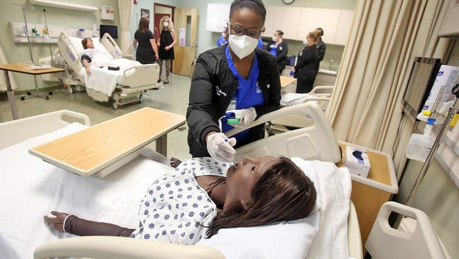 Rosalind McGadney-Camara works on patients at Cleveland Community College's nursing lab on Monday. CCC will be leaving a consortium in 2022 so more students can enroll in the nursing program.